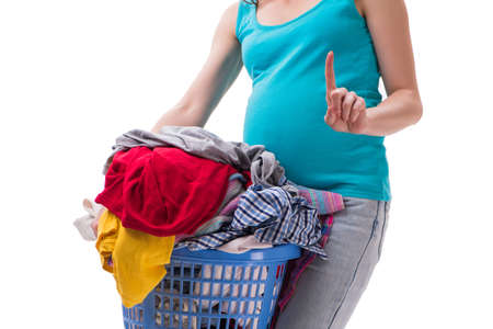 Woman holding basket of dirty clothing requiring washing