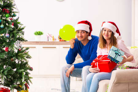 Young couple celebrating christmas at home