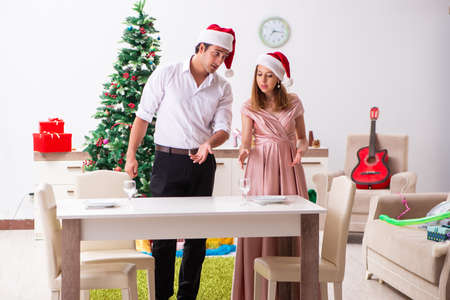Young couple preparing for christmas meal
