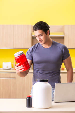 Young man blogging about food supplements Standard-Bild - 110194927