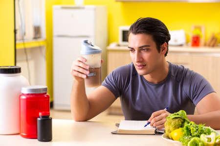 Junger Mann im Konzept der gesunden Ernährung