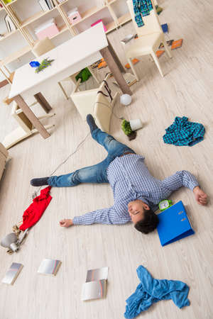 Dead man after burglary at home Stock Photo