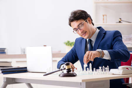 Young lawyer playing chess to train his court strategy and tactics Stock Photo