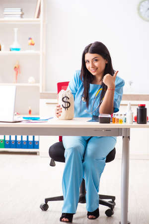 Young beautiful female doctor working in the clinic