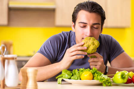 Young man in dieting and healthy eating concept Stockfoto