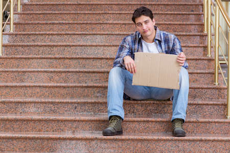 Young man begging money on the street Stock Photo