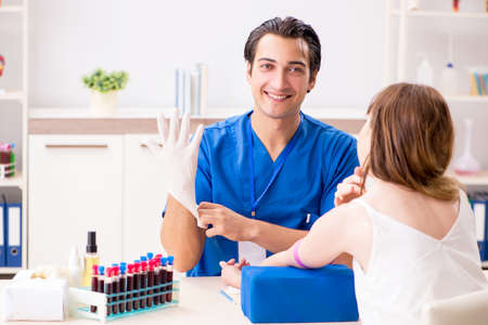 Young patient during blood test sampling procedure Stock Photo