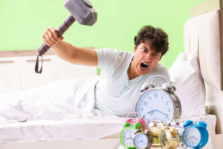 Young man having trouble waking up in early morning Standard-Bild