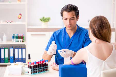 Young patient during blood test sampling procedure Foto de archivo