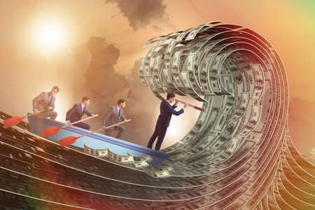 Businessman leading his team through wave of dollars