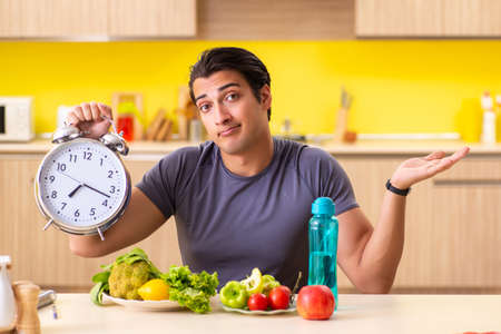 Young man in dieting and healthy eating concept Foto de archivo