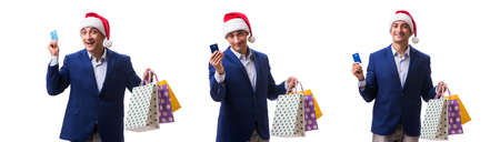 Young man with bags after christmas shopping on white background Stock Photo