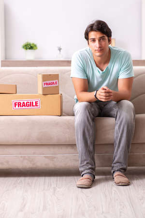 Man opening fragile parcel ordered from internet