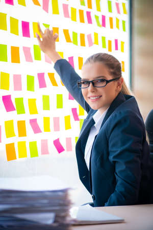 Beautiful female employee with many conflicting priorities Stock Photo