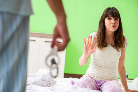 Man suggesting wife to play games with cuffs