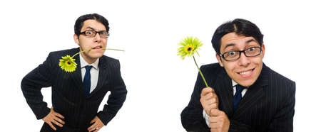 Jeune homme en costume noir avec fleur isolé sur blanc Banque d'images