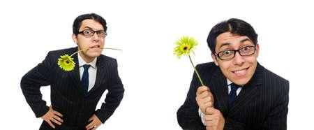 Junger Mann im schwarzen Kostüm mit Blume isoliert auf weiß Standard-Bild