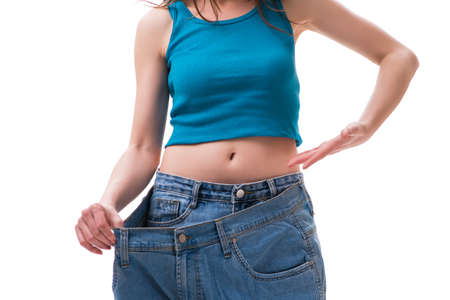 Concept of dieting with oversized jeans Imagens