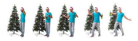 Young man decorating christmas tree isolated on white Stock Photo