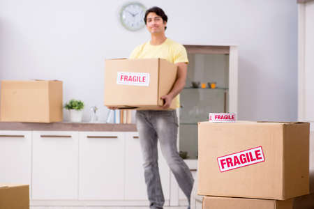 Man moving house and relocating with fragile items 스톡 콘텐츠
