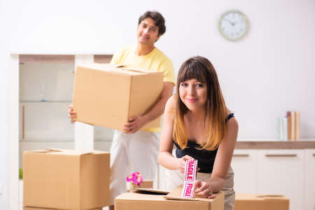 Young pair moving to new flat with fragile things Stock Photo
