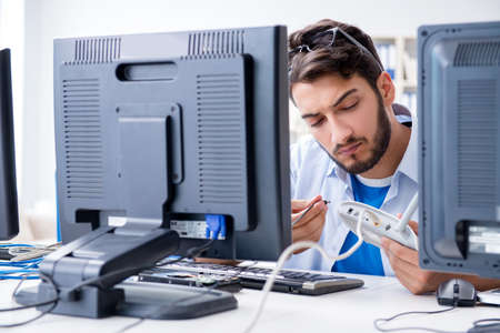 IT technician looking at IT equipment