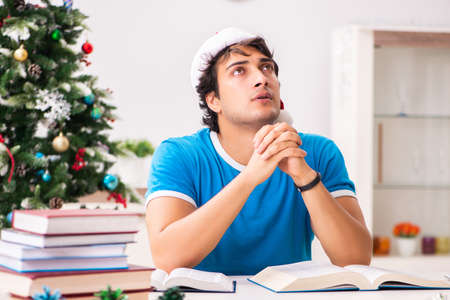 Young student with book at Christmas eve