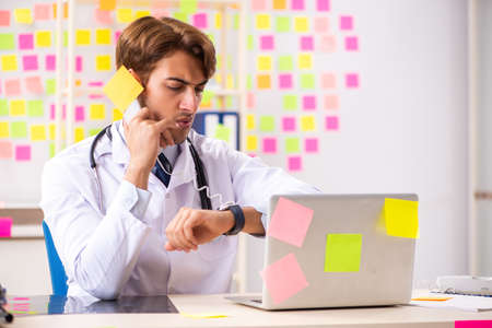 Male doctor with many conflicting prioritites