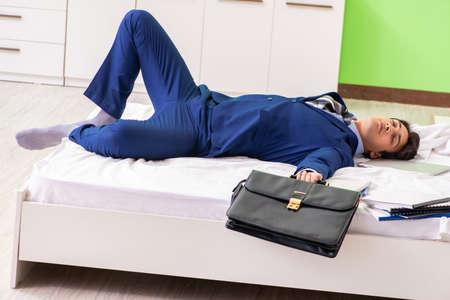 Businessman working overtime in room