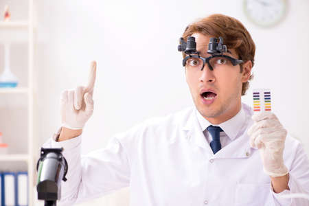 Chemist in the lab checking with ph strips Stock Photo