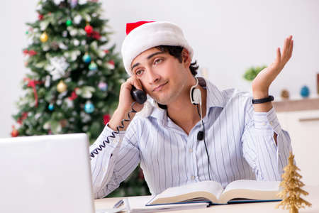 Telesales operator during christmas sale on the phone