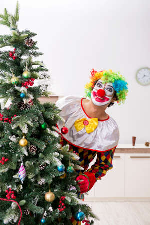 Funny clown in Christmas celebration concept Stockfoto