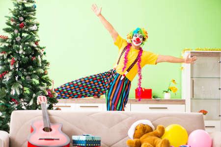 Funny clown in Christmas celebration concept Standard-Bild