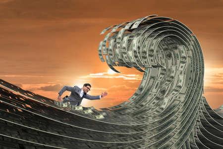 Businessman swimming in the sea of dollar money 免版税图像