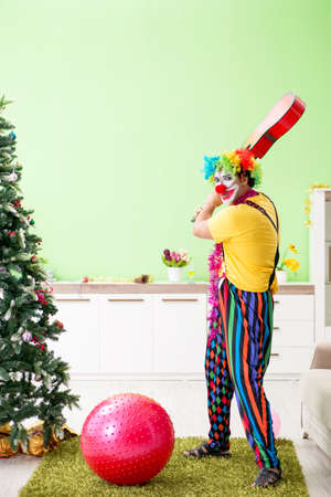 Funny clown in Christmas celebration concept Archivio Fotografico