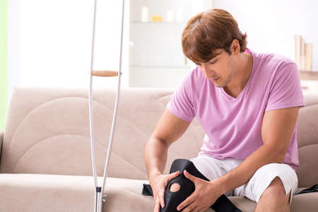 Injured man recovering at home from sports injury