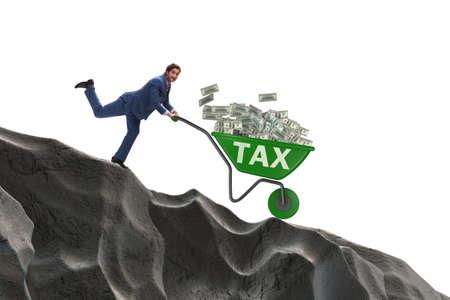 Businessman pushing wheelbarrow with tax money