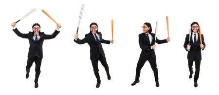 Young elegant man in black suit holding bat isolated on white 写真素材