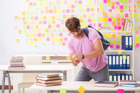 Student preparing for exams with many conflicting priorities Stock Photo