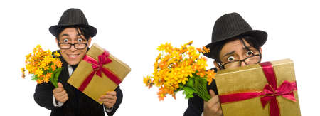 Gentleman with gift box and flowers isolated on white Stock Photo