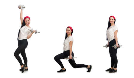 Young woman exercising with dumbbells 免版税图像
