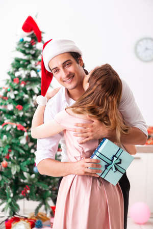 Young couple celebrating christmas at home Stock Photo