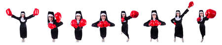 Nun with boxing gloves isolated on white Stock Photo