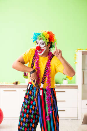 Funny clown in Christmas celebration concept Imagens