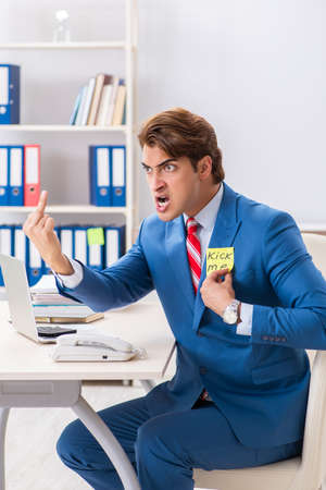 Office prank with kick me message on sticky note Banco de Imagens