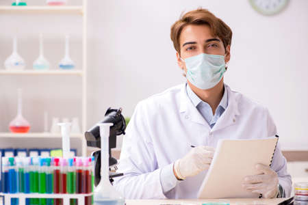 Young chemist working in the lab Stock Photo