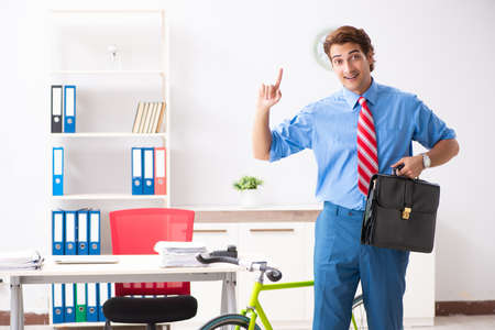 Young businessman using bike to commute to the office Stock Photo