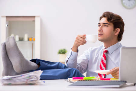 Young attractive businessman working in the office