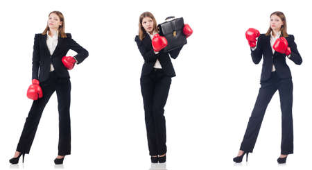 Businesswoman with boxing gloves isolated on white Stock Photo - 113319173