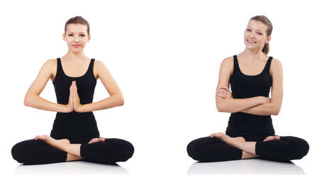 Young woman sitting cross-legged and doing yoga Stock Photo
